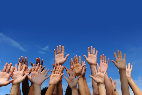 Hands raised in the air, depicting accountability